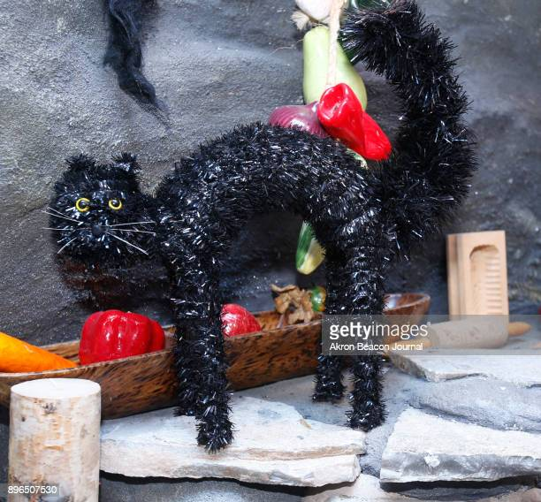 According to Icelandic Christmas folklore this black cat belonged to the half ogre/half troll Gryla at the Troll Hole Museum on December 6 in...