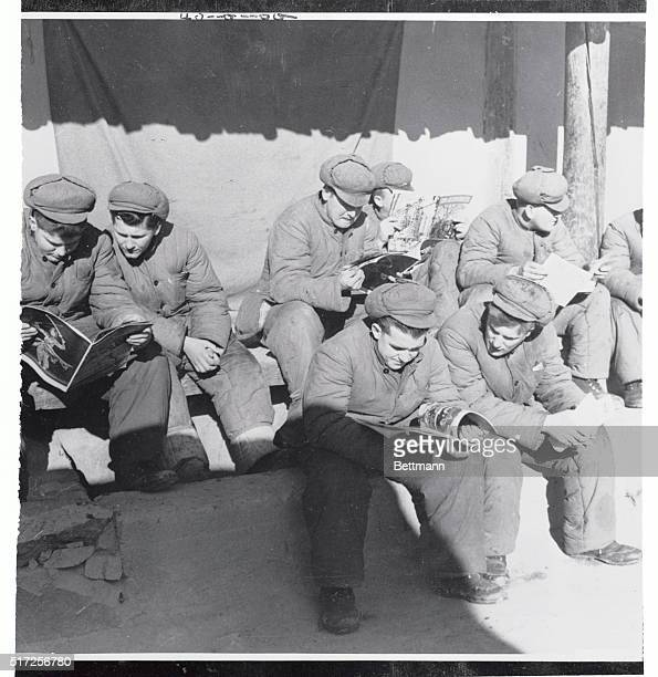 According to the caption supplied by a communist source these men are American soldiers held prisoner in a red POW camp The caption identifies the...