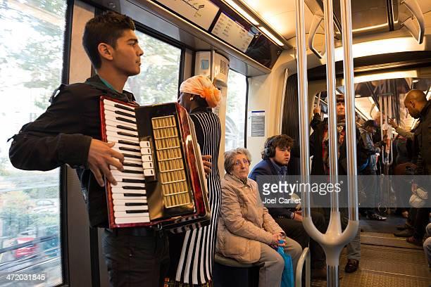 Accordion musician busking on Paris metro, France