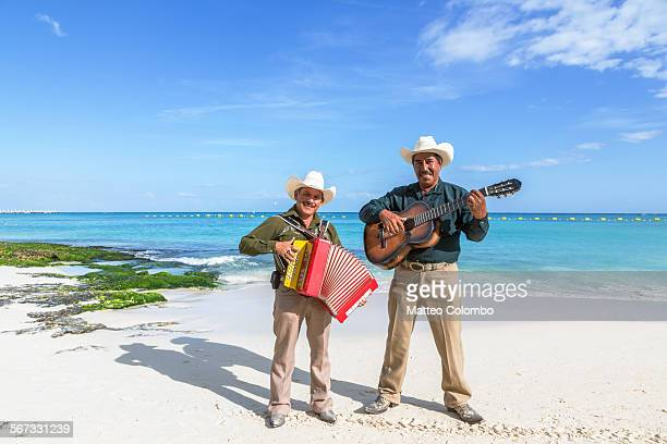Accordion player and guitarist on a beach, Mexico