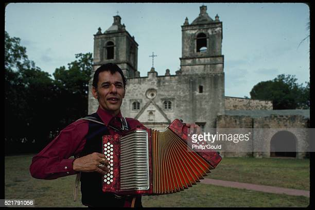 accordion player in front of church - accordionist stock pictures, royalty-free photos & images