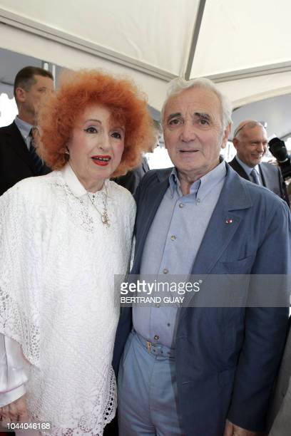 Accordionist Yvette Horner poses with singer Charles Aznavour on July 1 2005 in Paris during the opening ceremony of the square in honor of...