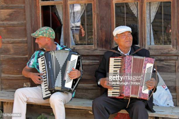 accordionists in jervana - accordionist stock pictures, royalty-free photos & images