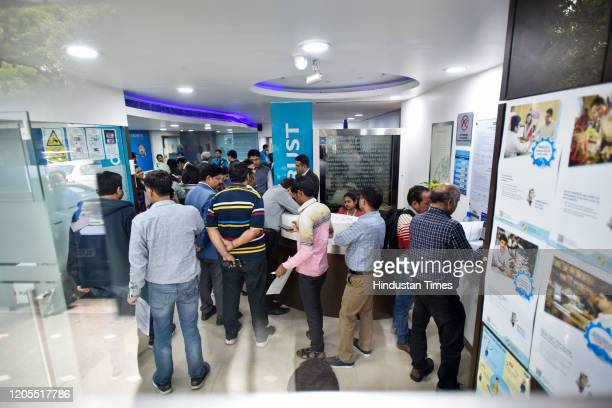 Account holders are seen inside the Yes Bank branch office at Janpath, in New Delhi, India, on Friday, March 6, 2020.