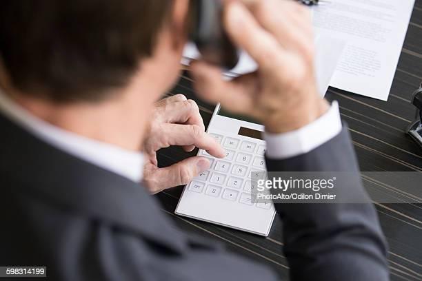Accountant reviewing financial accounts