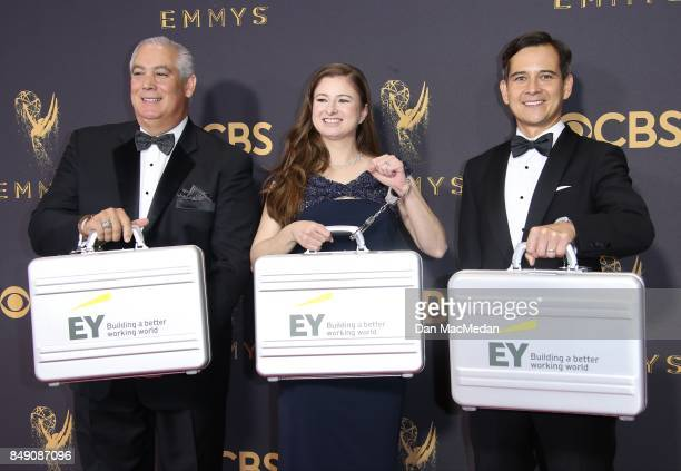 Accountants from Ernst and Young arrive at the 69th Annual Primetime Emmy Awards at Microsoft Theater on September 17 2017 in Los Angeles California