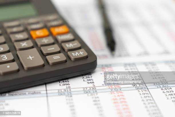 accounting,account,calculator and pen - accountancy stock pictures, royalty-free photos & images