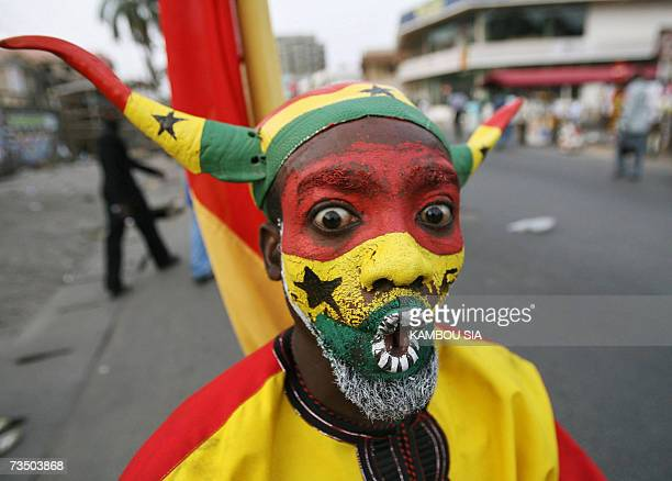 A man painted with Ghanaian colours dances during celebrations of the 50th anniversary of Ghana's independence in Accra 06 March 2007 Kufuor said in...