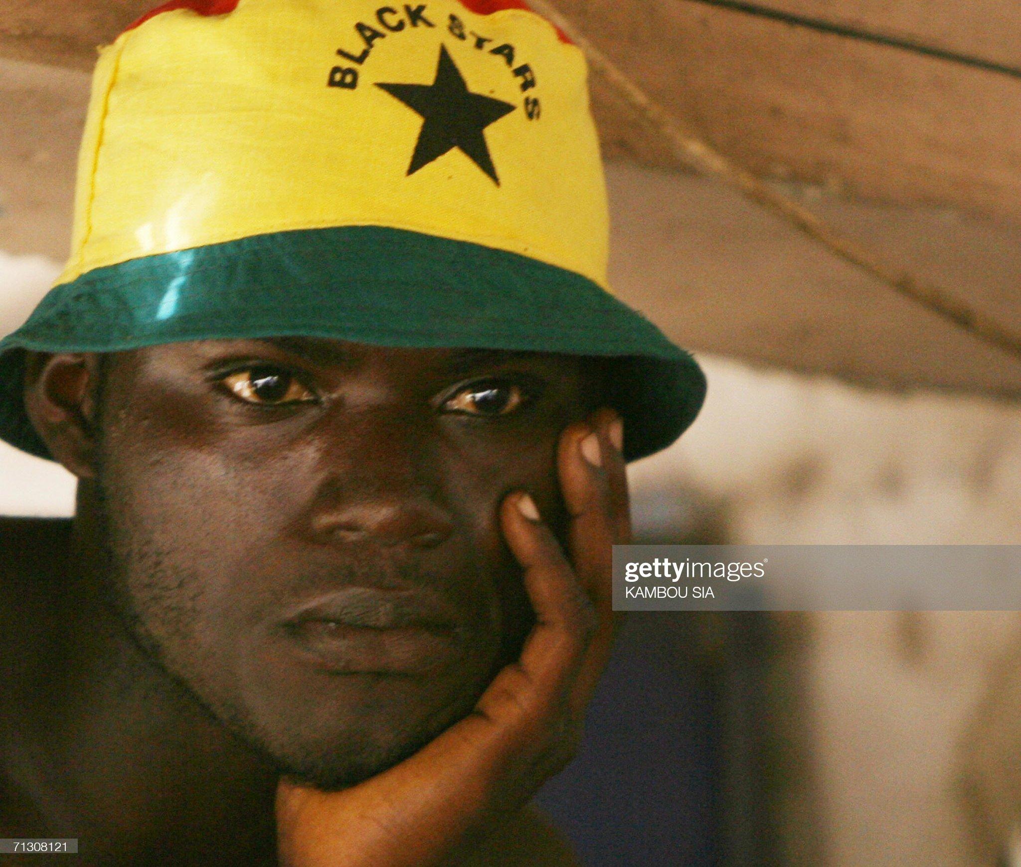 A young Ghanaian football fan looks sad : News Photo