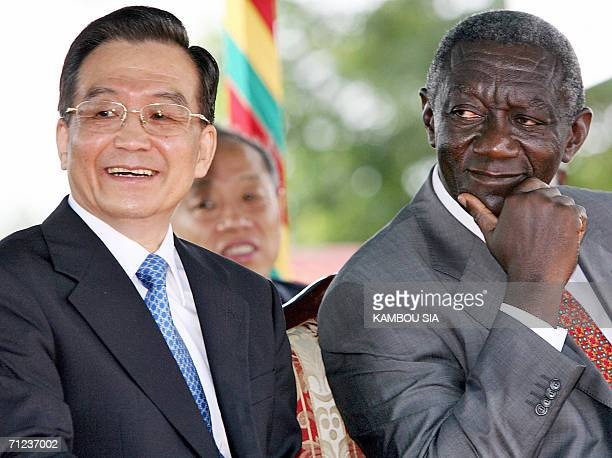 Chinese Prime Minister Wen Jiabao touring Africa in quest of resources and markets and Ghanian president John Agyekum Kufuor attend a ceremony to...