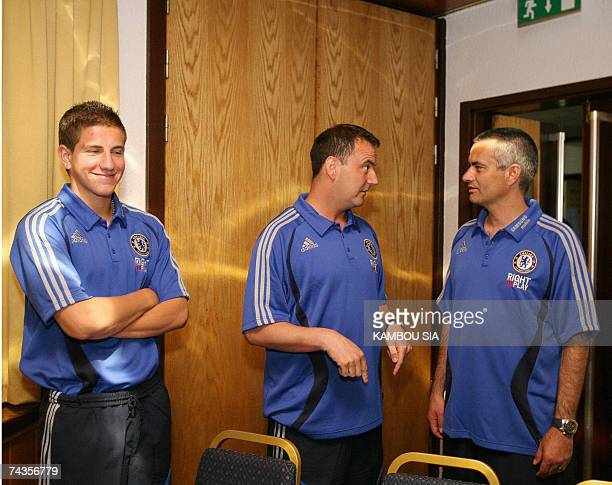 English football club Chelsea manager Jose Mourinho speaks with the club's academy manager Neil Bath and defender Sam Hutchinson before a press...