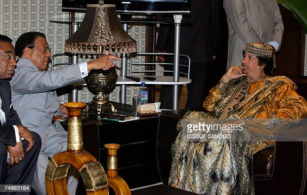 Libyan leader Moamer Kadhafi receives exmayor of Atlanta Andrew Young 03 July 2007 in Accra 2007 on the final day of the African Union summitThe...