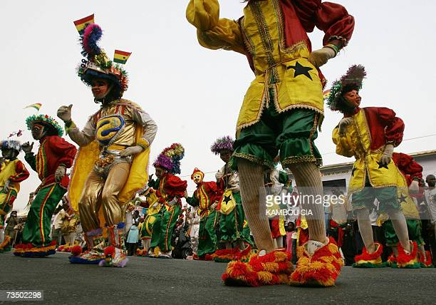 Men wearing the colors of the Ghanian flag dance during celebrations of the 50th anniversary of Ghana's independence in Accra 06 March 2007 Kufuor...