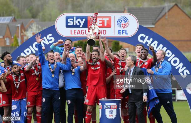 Accrington Stanley players and staff celebrate after winning the league after the Sky Bet League Two match between Accrington Stanley and Lincoln...