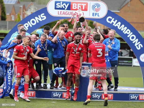 Accrington Stanley players and staff celebrate after winning the league afer the Sky Bet League Two match between Accrington Stanley and Lincoln City...