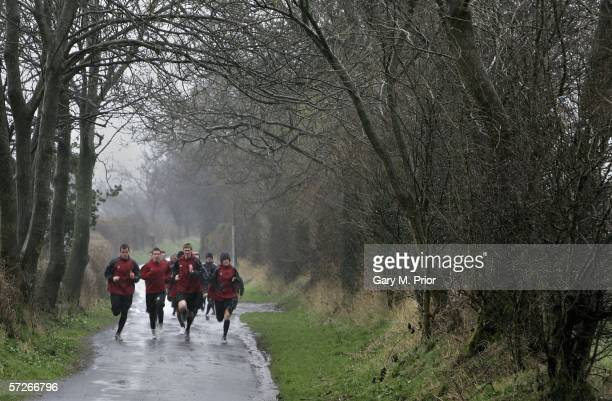Accrington Stanley players go out jogging in the rain at the Rolls Royce training ground on April 6 2006 in Barnoldswick England
