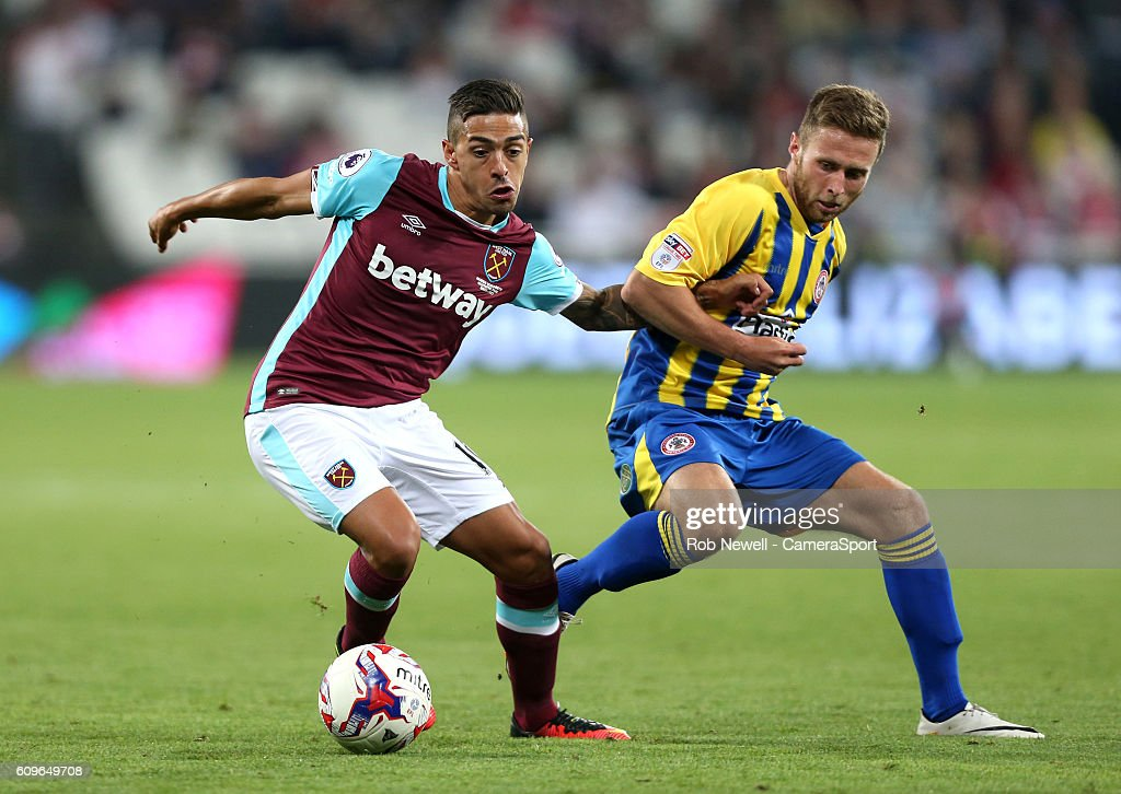 Accrington Stanley's Jordan Clark and West Ham United's Manuel Lanzini during the EFL Cup Third Round match between West Ham United and Accrington Stanley at London Stadium on September 21, 2016 in Stratford, England.