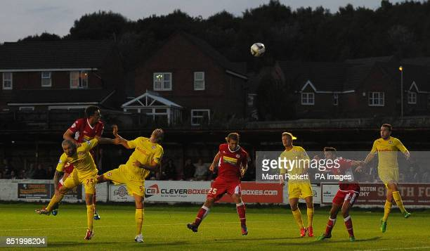 Accrington Stanley's Kai Naismith battles for the ball with Cardiff City's Kevin McNaughton and Mark Hudson during the Capital One Cup Second Round...