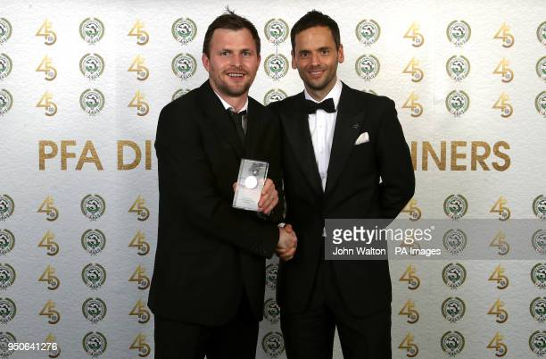 Accrington Stanley's Mark Hughes and PFA chairman Ben Purkiss poses with the PFA League Two Team of the Year award during the 2018 PFA Awards at the...