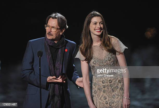 """Acctor Gary Oldman and actress Anne Hathaway speak onstage at Spike TV's """"SCREAM 2011"""" awards held at the Universal Studios Backlot on October 15,..."""
