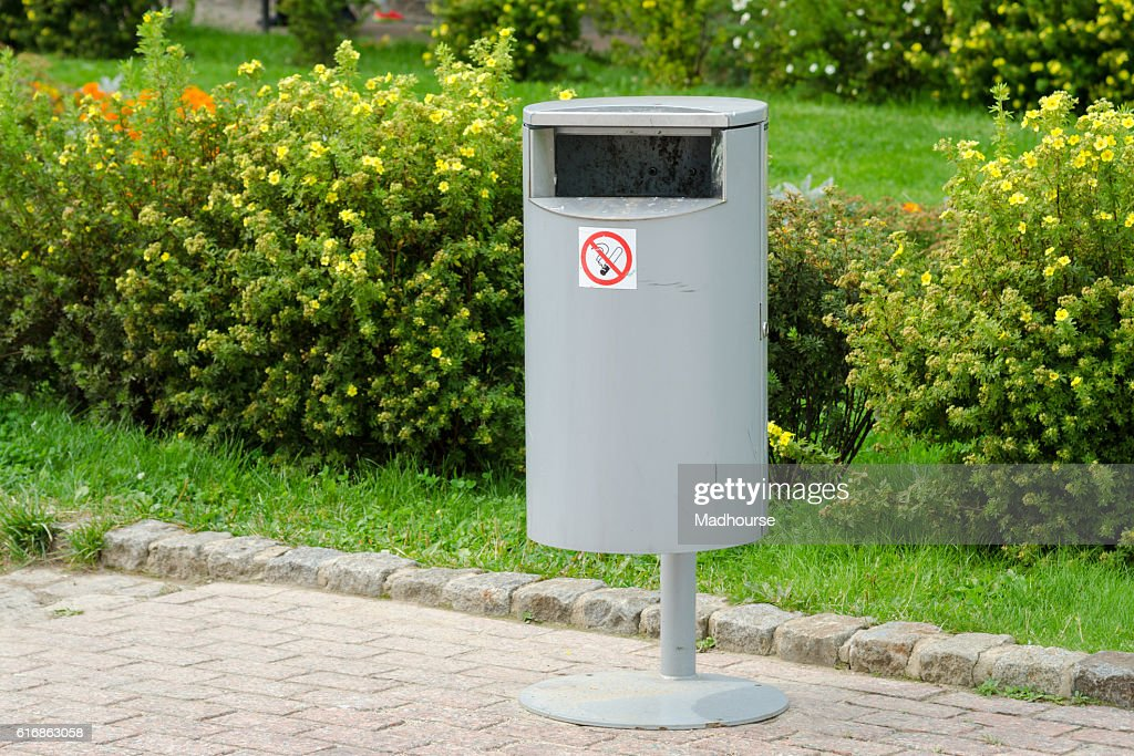 Accurate cylindrical metal rubbish bin on a background : Stock Photo