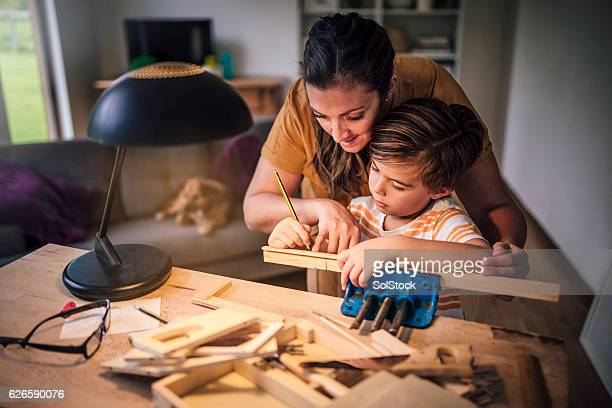 accurate measuring together - design occupation stock pictures, royalty-free photos & images
