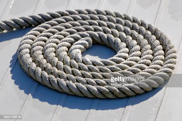 Accurately coiled rope on a deck, symbolic image for beginning or order, Kiel, Schleswig-Holstein, Germany