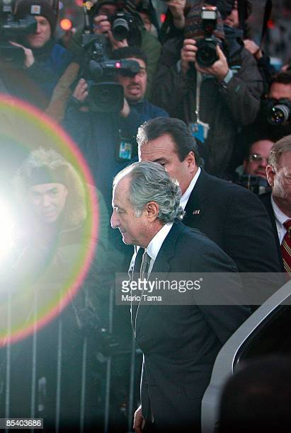 Accused $50 billion Ponzi schemer financier Bernard Madoff enters a Manhattan Federal courthouse past a strobe flashed by the media throng March 12...