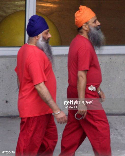 Accused Air India bombers Ajaib Singh Bagri and Ripudaman Singh Malik walk together through the exercise yard at the jail where they are in custody...