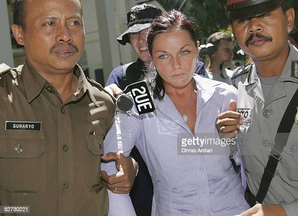 Accused Australian Drug Runner Schapelle Corby is escorted by Indonesian Police officers after her trial on April 28, 2005 at Denpasar Court, Bali,...