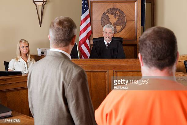 accused criminal and lawyer in a courtroom - sentencing stock pictures, royalty-free photos & images
