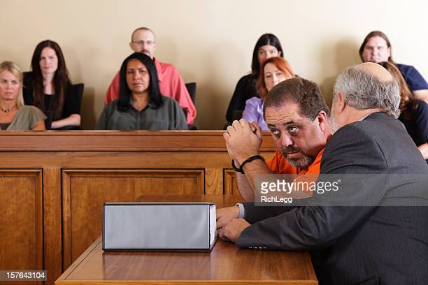 accused criminal and lawyer in a courtroom - defendant stock pictures, royalty-free photos & images