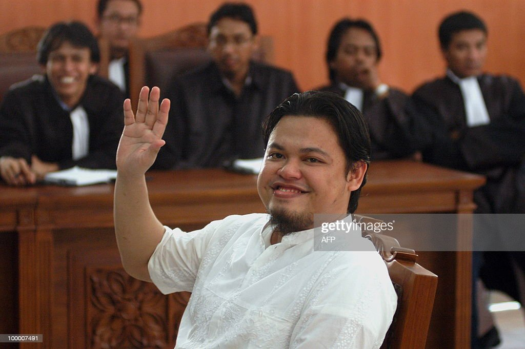 Accused Indonesian Mohammed Jibril Abdurahman waves before his trial at a court in Jakarta on May 20, 2010. Prosecutors sought seven years' jail for Mohammed Jibril, an Islamist blogger dubbed the 'Prince of Jihad' for allegedly abetting suicide attacks on luxury hotels in Jakarta last year. Mohammed Jibril, publisher of extremist literature and a militant blog, was arrested at his Ar-Rahmah media company a month after the July 17, 2009 bombings of JW Marriott and Ritz-Carlton hotels which killed seven people and two suicide bombers.