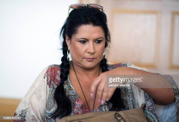 Accused Iris Klein mother of reality tv star Daniela Katzenberger sits in a court room of the district court in Frankenthal Germany 09 July 2013...