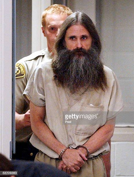 Accused kidnapper Brian David Mitchell is escorted into 3rd District Court of Judge Judith Atherton for his second competency hearing July 7 2005 in...