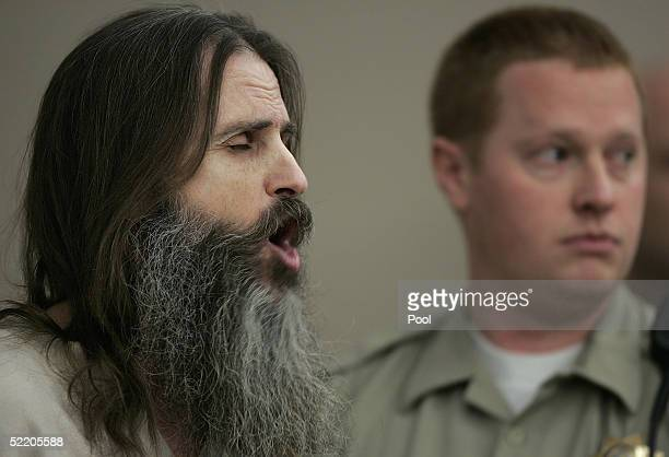 Accused kidnapper Brian David Mitchell sings a hymn in court during his competency hearing while bailiff Tom Hutchinson stands near by February 16in...