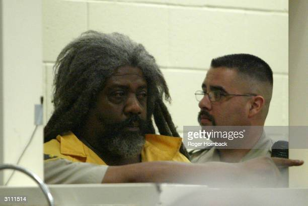 Accused killer Marcus Wesson waits to see the judge during his arraignment March 17 2004 in Fresno California Wesson is accused of shooting nine...