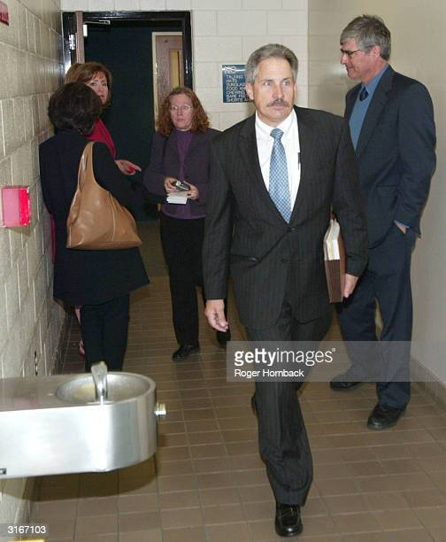 Accused murderer Marcus Wesson's Public Defender Pete Jones leaves the courtroom after Wesson's court appearance March 30 2004 in Fresno California...