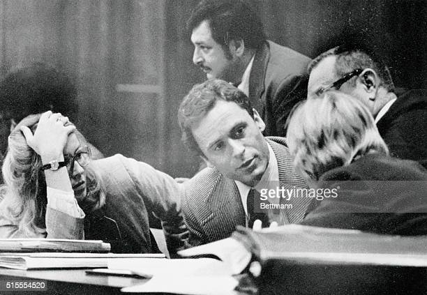 Accused murderer Theodore Bundy confers with his defense attorneys on the opening day of his trial 6/25. The trial will be televised nationwide as...