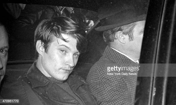 Accused of brutal slaying of Roseann Quinn 23yearold drifter John Wayne Wilson casts a dark look from police car which took him from LaGuardia...
