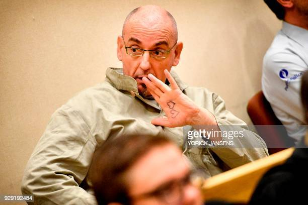 Accused Renaud Hardy gestures during the final session of his assize trial before the Assize Court of Limburg in Tongeren on March 8 2018 55yearold...
