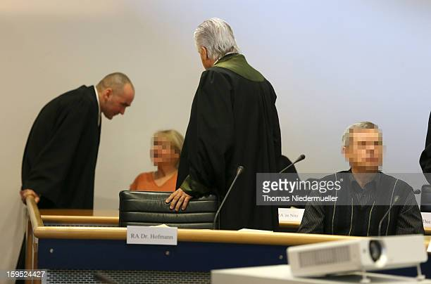 Accused Russian spies with the aliases Andreas and Heidrun Anschlag appear in court on the first day of their trial on January 15 2013 in Stuttgart...