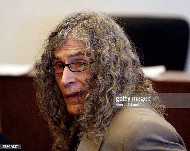 Accused serial killer Rodney James Alcala confers with his investigator Alfredo Rasch not pictured as he is convicted on five counts of murder in...