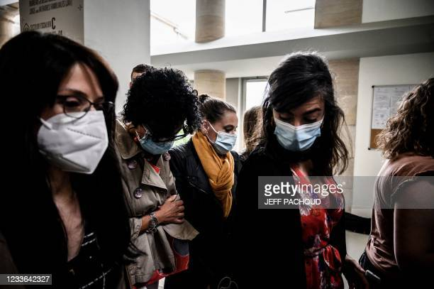 Accused Valerie Bacot arrives flanked by relatives at the Chalon-sur-Saone Courthouse, central-eastern France, on June 25, 2021 on the last day of...