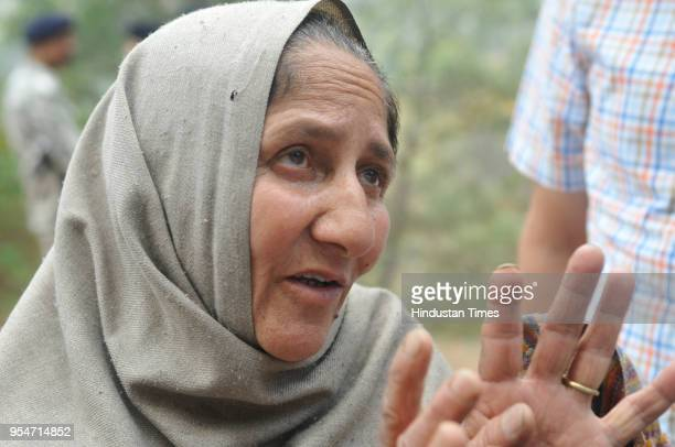 Accused's mother trying to talk with her son after investigation on May 4 2018 in Kasouli India The police arrested Vijay Singh accused of killing...