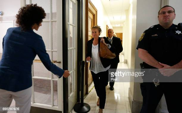 Accuser Andrea Constand waits for her mother Gianna Constand outside the courtroom after closing arguments in the sexual assault trial of entertainer...