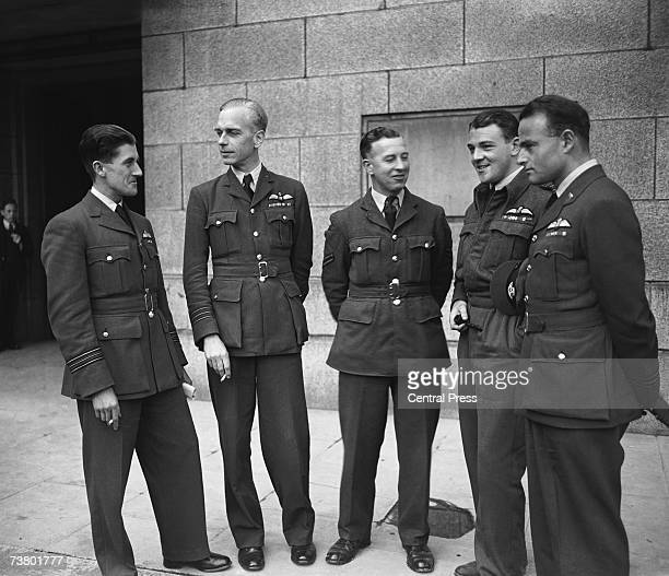 Ace British pilots meet for a conference at the Ministry of Information during World War II 8th September 1944 From left to right Squadron Leader...