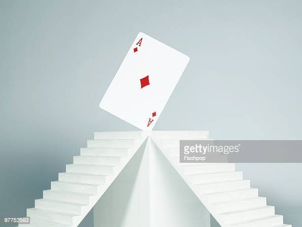 ace card balancing on plinth - symmetry stock pictures, royalty-free photos & images