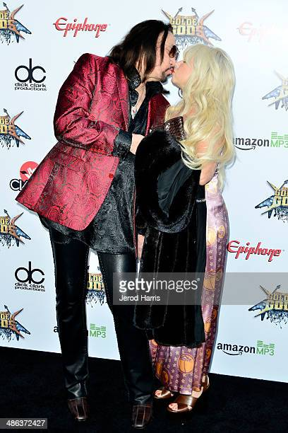 Ace Frehley and wife Jeanette Trerotola kiss at the 2014 Revolver Golden Gods Awards at Club Nokia on April 23 2014 in Los Angeles California