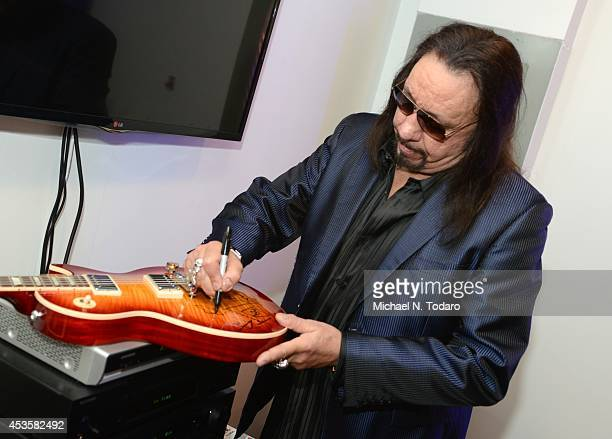 Ace Frehley Signs A Les Paul Standard 12 String Guitar At The Listening Party